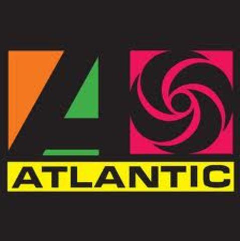 Firmo con tlantic Records