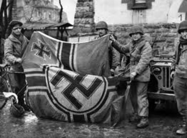 Ending World War II, Hitler commits suicide