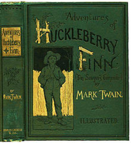 "Mark Twain finishes writing ""The Adventures of Huckleberry Finn"""