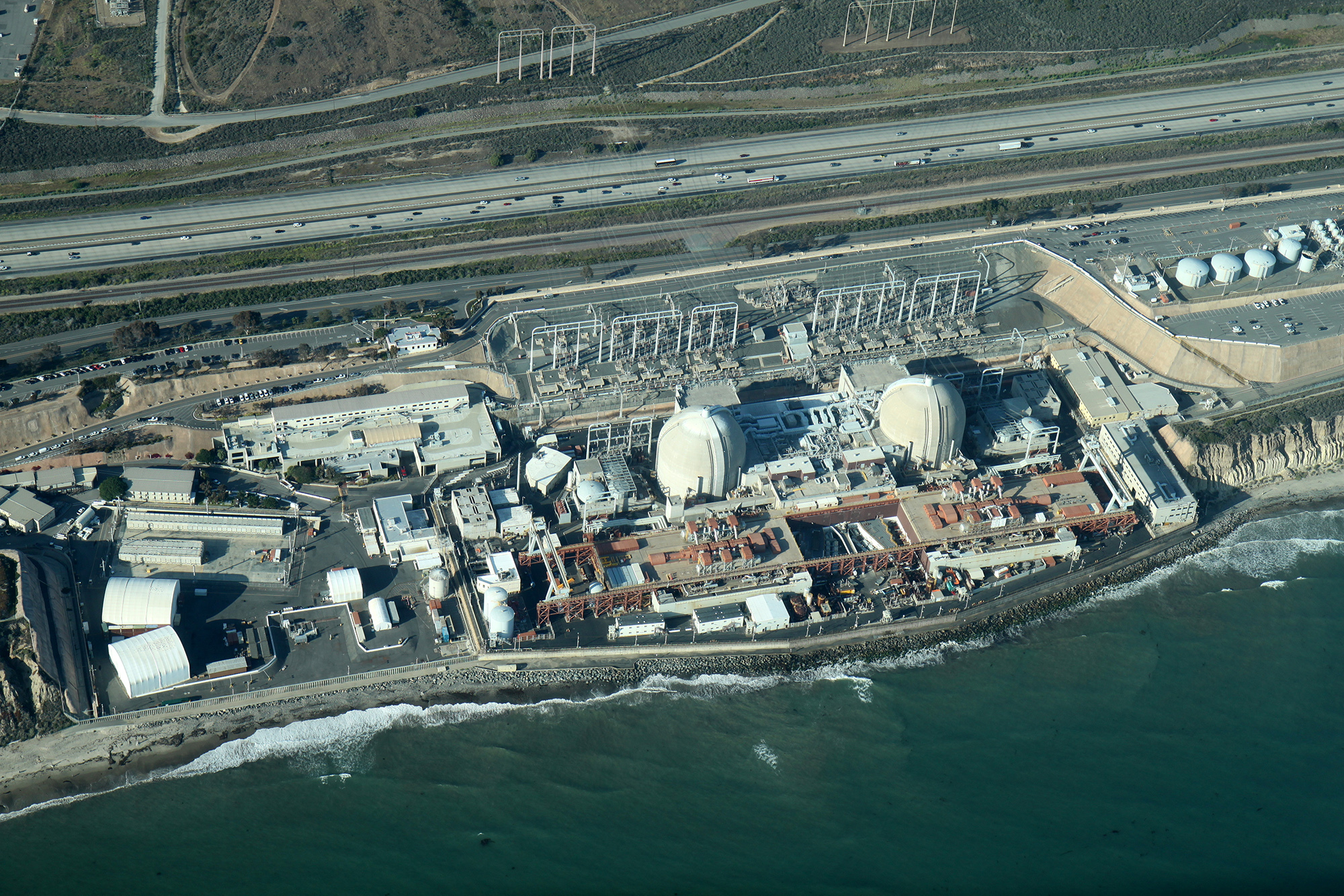 Facilities like power stations are often built on coasts to take advantage of an abundant supply of coolant or water for heating.