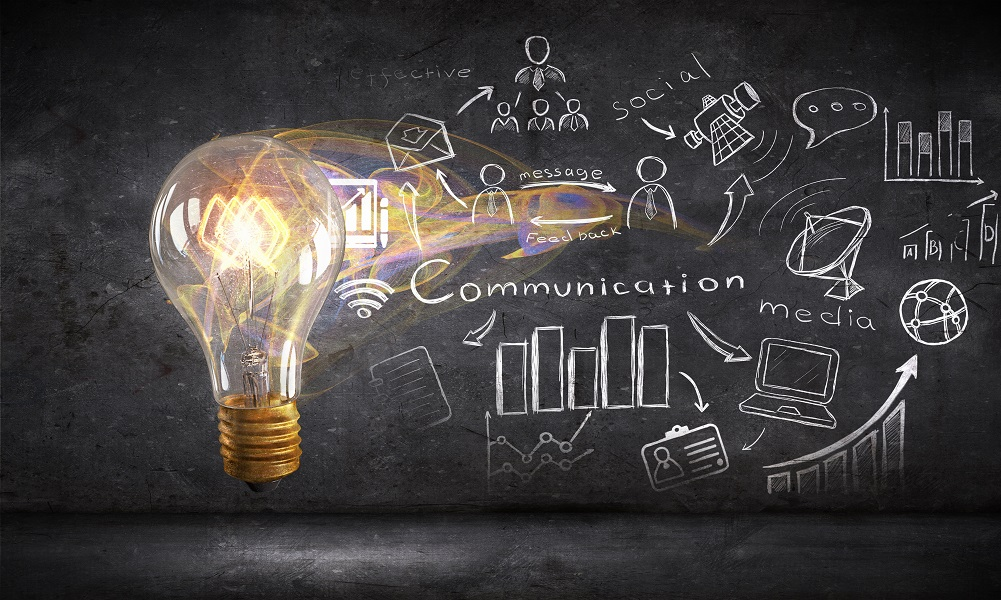 Glass glowing light bulb and business sketched ideas for marketing cybersecurity