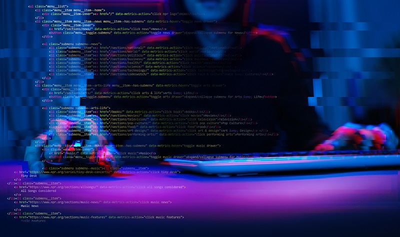 As ransomware on the rise, we see a hacker working with computer in dark room with digital interface around.