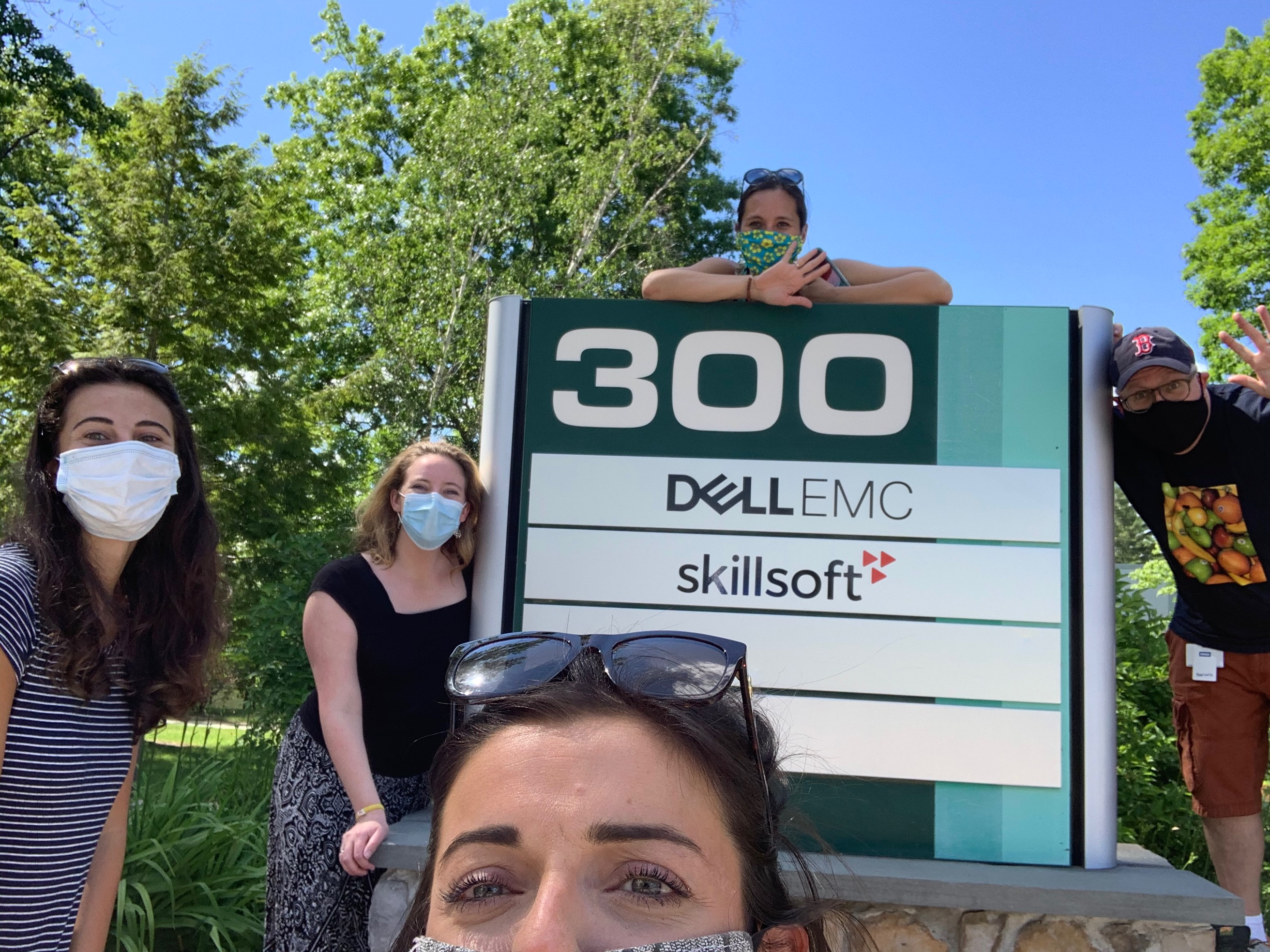 My team and I social distancing outside the Skillsoft office