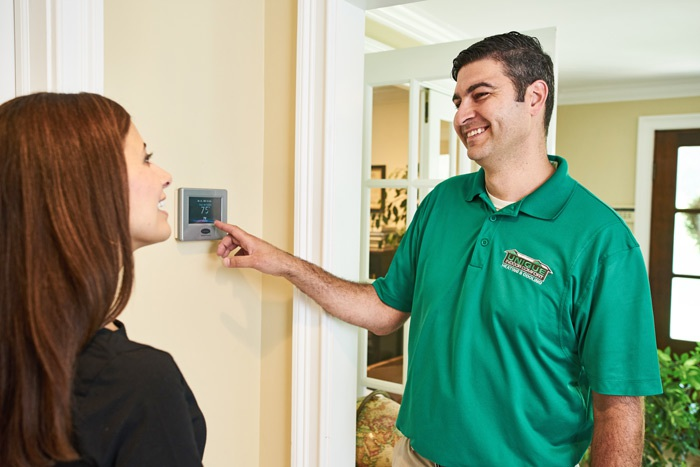 Contractor discussing air conditioning services with consumer