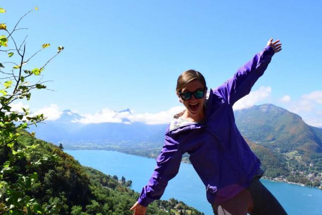 Happy teen overlooking nature on Alps adventure summer program