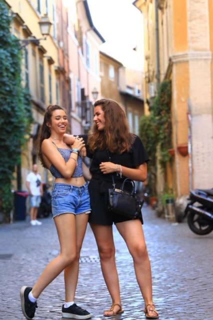 High school teens laugh on the winding streets of Italy on their summer teen tour.