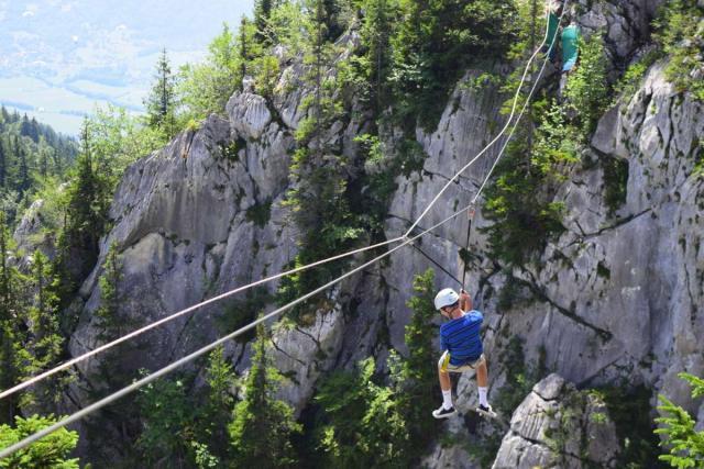 Teen ziplining on Europe adventure tour in summer