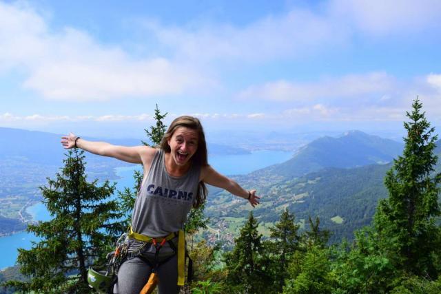 Happy teen overlooking wilderness on Alps adventure summer program