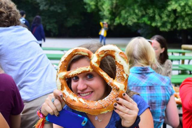 Teen traveler eats pretzel during summer youth program in Germany