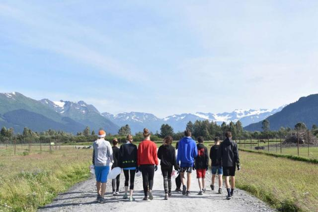 Student group walks in the wild of Alaska on their summer service program.