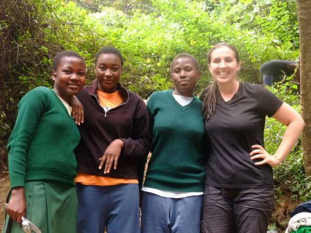 Teens go on a hike in Tanzania during their summer service program.