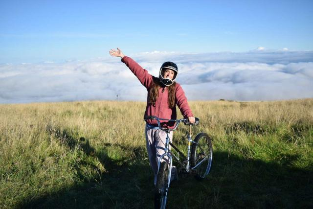Students go mountain biking on summer teen service program in North America.