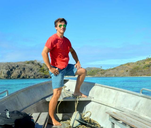 Teen traveler aboard boat during summer youth program in Fiji
