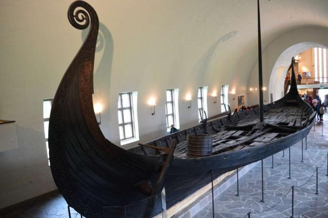 Ancient Viking ship seen by teenage travelers during summer youth travel program in Scandinavia