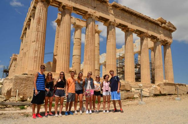 Teenage travelers at Greek Acropolis in Athens during summer youth travel program in Greece