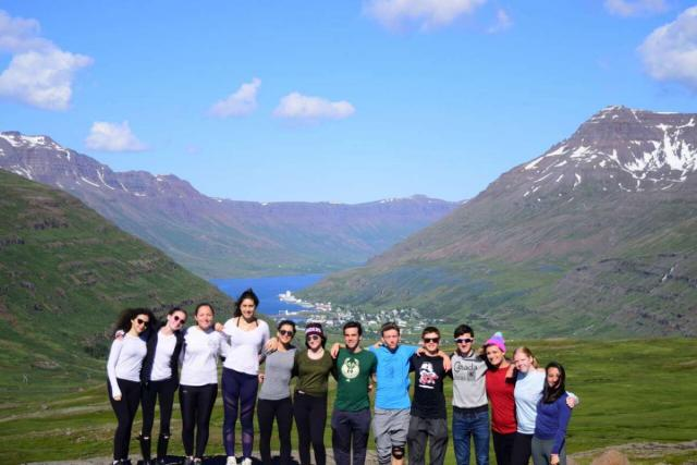 Teen travelers with Icelandic landscapes during summer adventure travel program