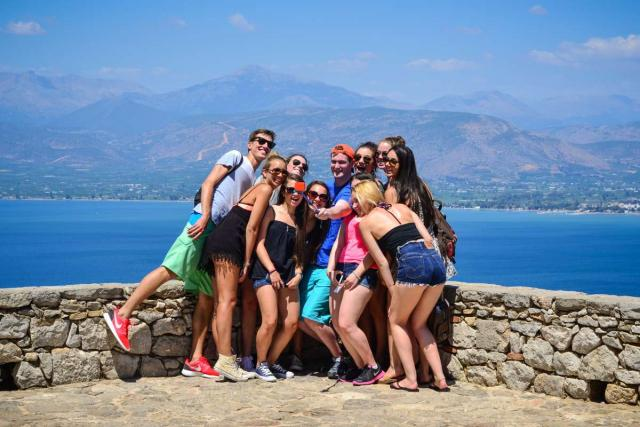 High school students pose in Greece on their summer tour.