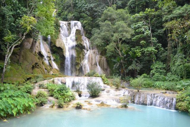 Waterfall seen by teenage travelers during summer youth program in Southeast Asia