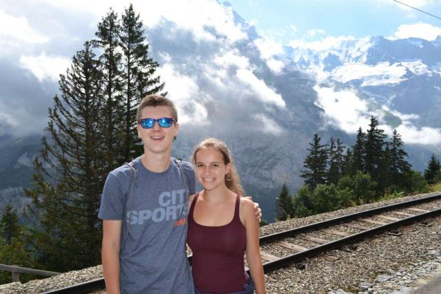Teen travelers travel by train across Switzerland on summer youth trip in Europe