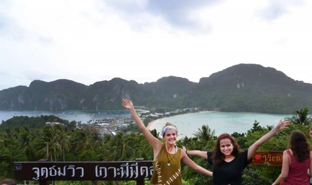 Teenage travelers enjoy landscape views during summer youth travel program in Thailand