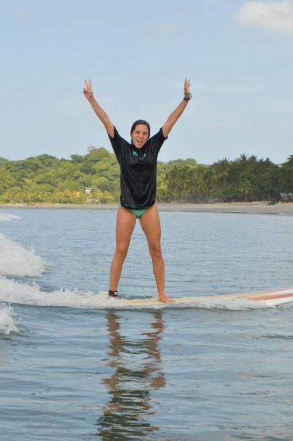 A student learns how to surf on a summer adventure tour of Costa Rica.