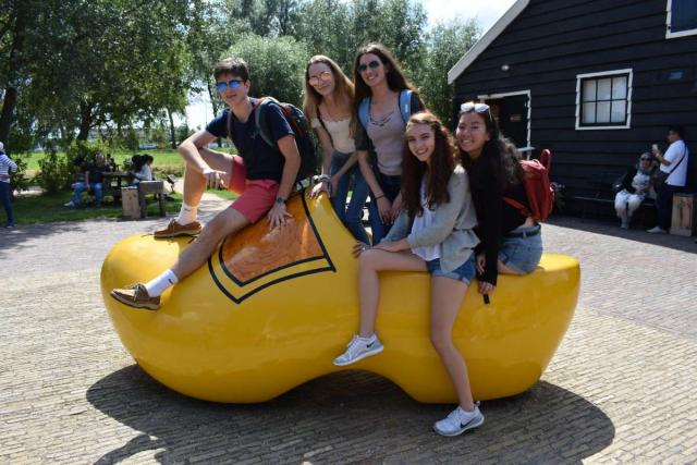 Teen travelers in Dutch wooden clog during summer program in Amsterdam