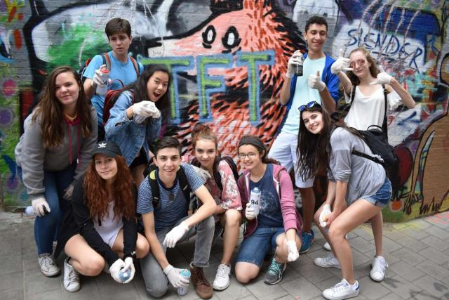 Teen travelers do street art tour in Europe on summer teen travel program
