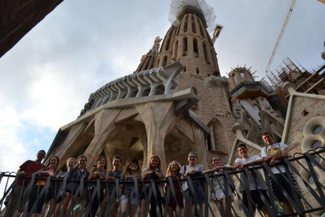 Teen travelers explore Sagrada Familia Barcelona on youth trip to Spain