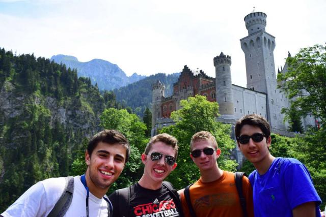 Teenage travelers explore Bavarian castles during summer travel tour