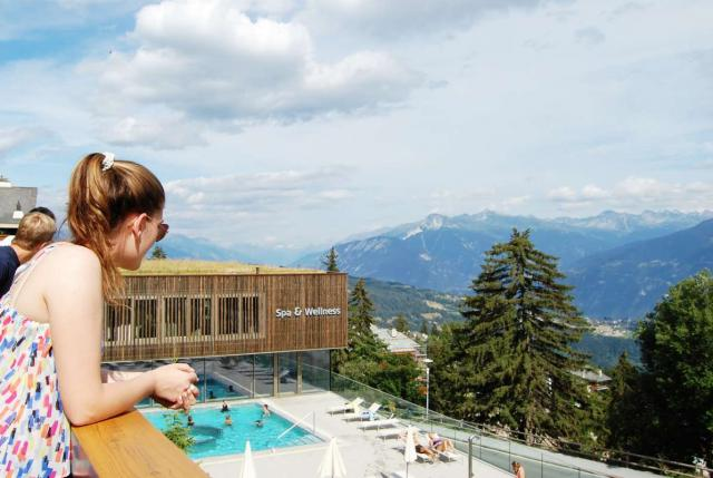 Teens enjoying spa in Swiss Alps during summer travel adventure program