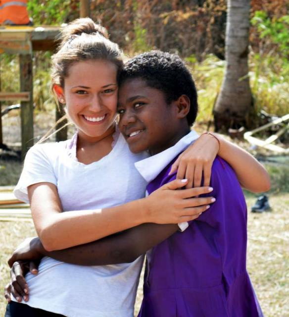 Teenage American traveler with local Fijian student during summer youth program in Fiji