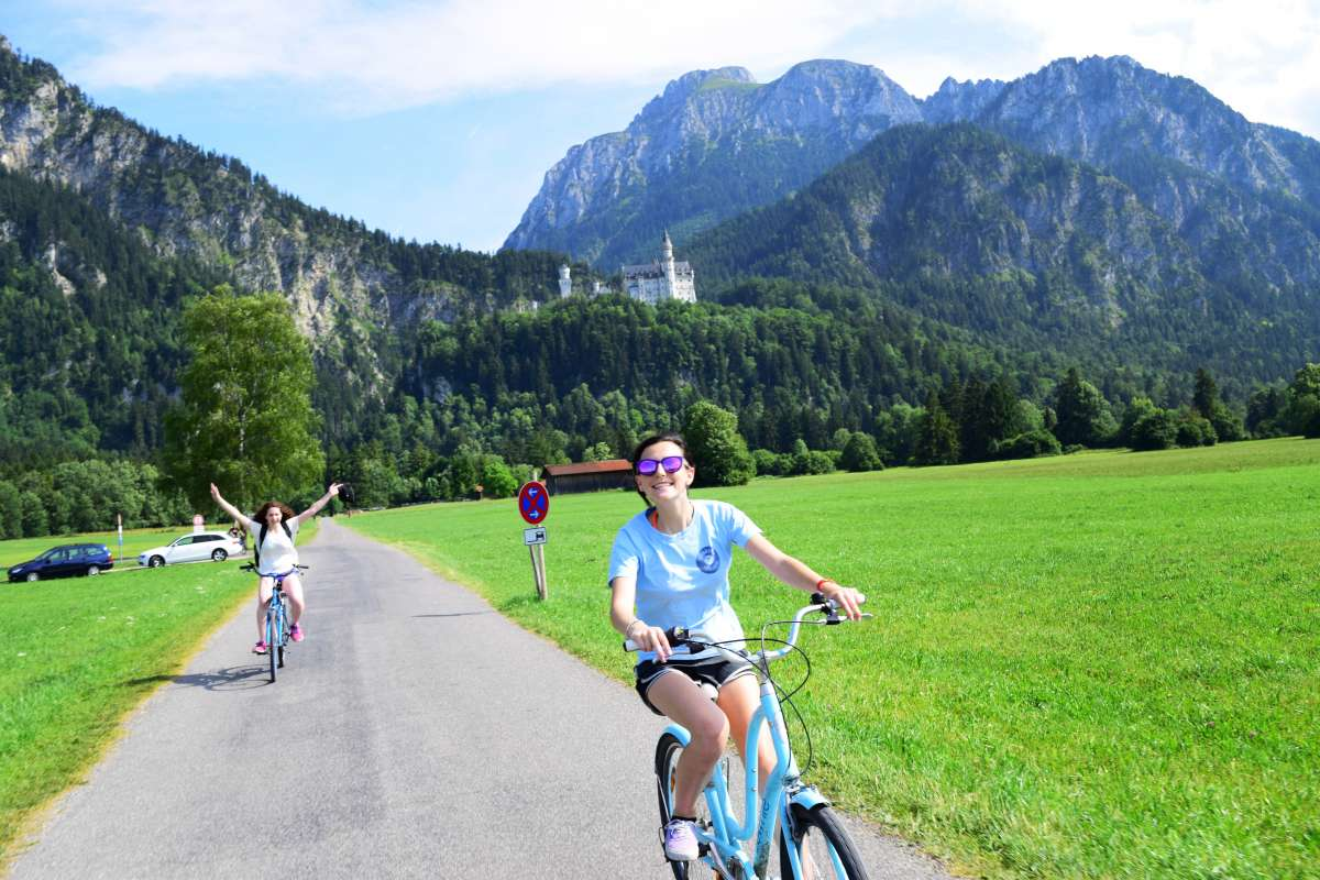 Teens bike through Bavaria Munich on summer adventure travel tour