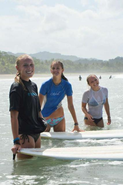 Students learn how to surf on their teen adventure tour of Costa Rica.