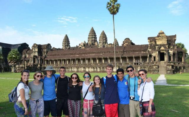 Teenage travelers visit Angkor Wat during summer youth travel program in Southeast Asia