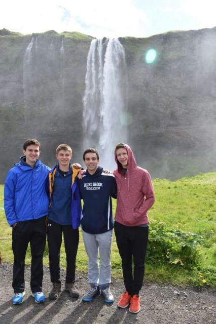 Teen travelers with waterfall on Iceland summer adventure travel program