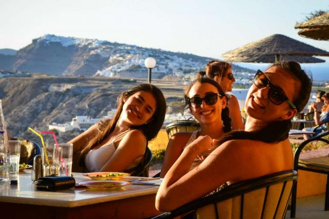 High school students bask in the sunset on Santorini on their summer teen tour to Greece.