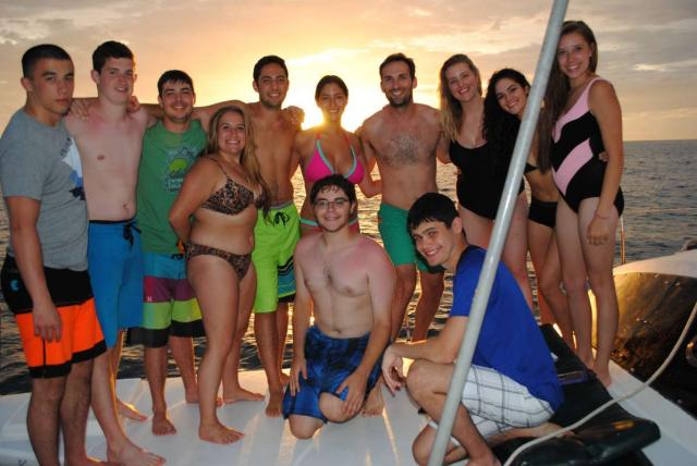 Students enjoy a sunset boat ride on their summer teen travel program in Costa Rica.
