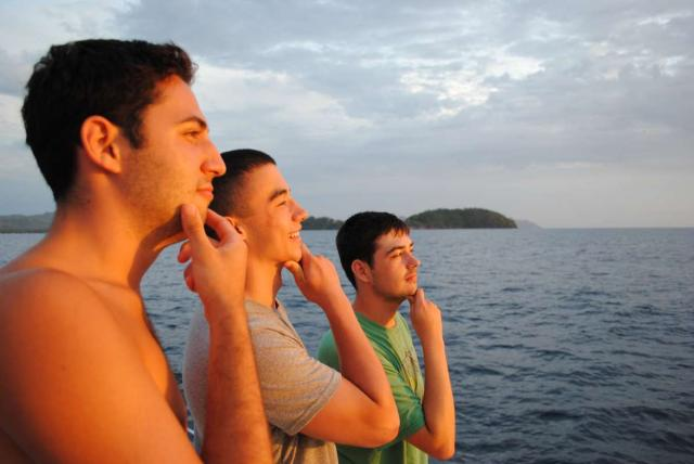 Teen boys enjoy the views on their summer adventure program in Costa Rica.