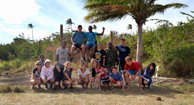 High school students pose for a photo on their summer teen tour to Fiji.