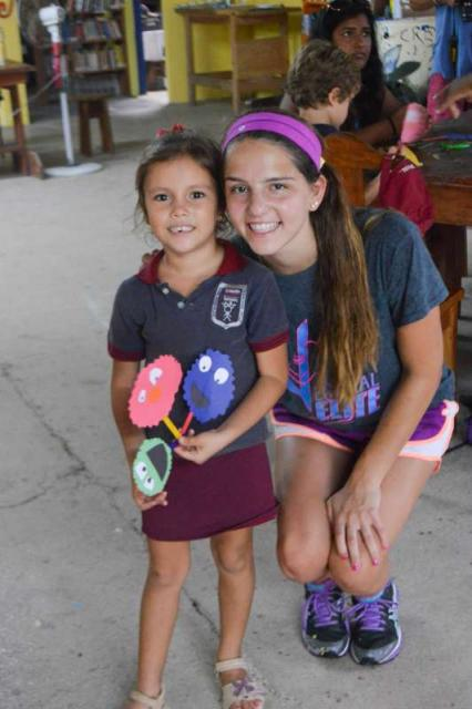 A student posts for a photo with a girl from Costa Rica on her community service program in Costa Rica.