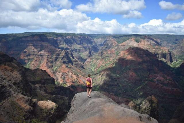 Teens trek to a canyon for epic views on ultimate service and adventure program in Hawaii.