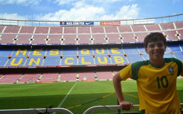 Teenager visits Barcelona football stadium on Spain summer travel program