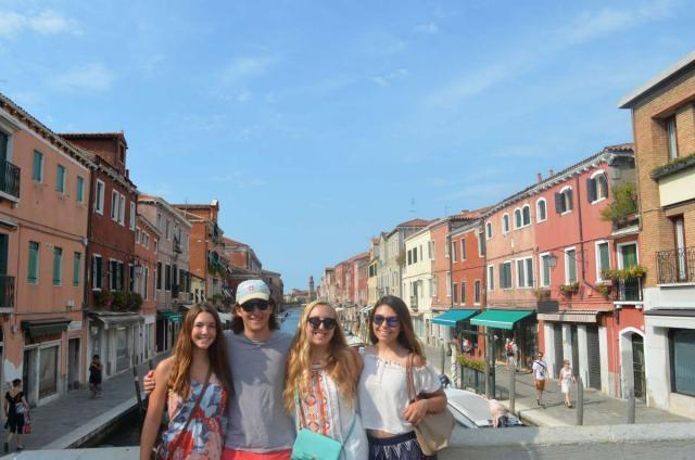 Teens pose in Venice on their summer tour through Italy with Travel For Teens.