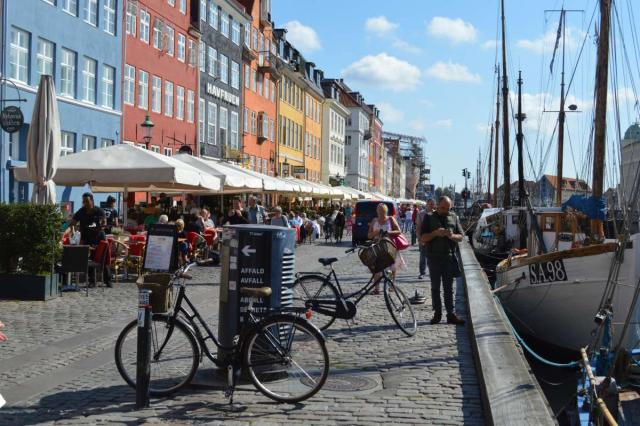 Copenhagen's Nyhavn harbor visited by teenage travelers during summer youth travel program in Scandinavia