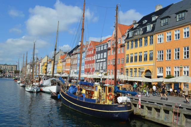 Copenhagen's Nyhavn harbor seen by teenage travelers during summer youth travel program in Scandinavia