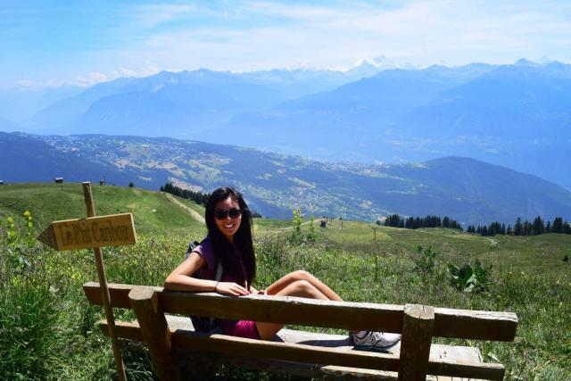 Teen hikes through Swiss Alps during summer adventure travel program
