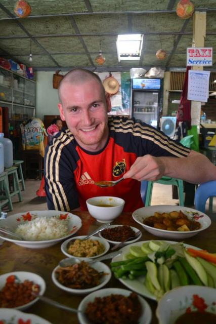 Teenage traveler eats local Thai cuisine during summer youth program in Southeast Asia