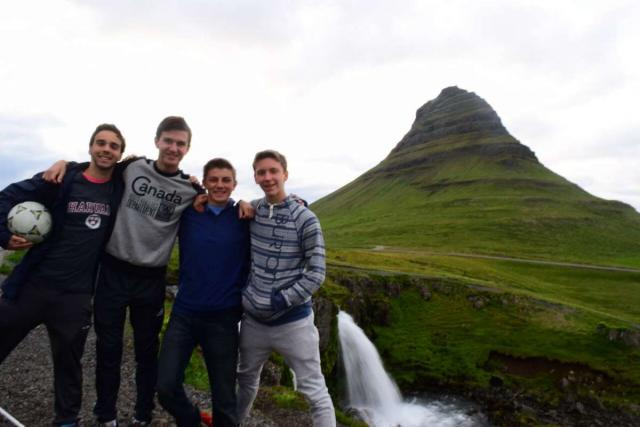 Teenage travelers at Kirkjufell Iceland during summer adventure travel program