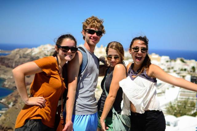 Happy teen travelers exploring Greek islands during summer youth travel program in Greece