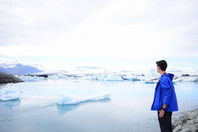 Teen at Iceland glacier lagoon during summer youth adventure travel program